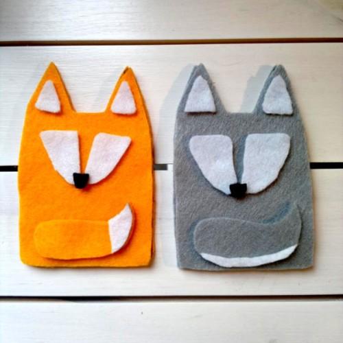 A felt fox and a felt wolf