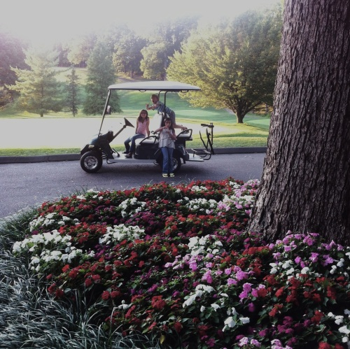 The kids on the golf cart at the country club.