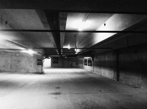Underground parking at night.